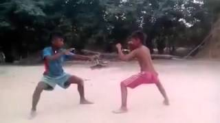 new bokator small boy in cambodia  ល្បុក្កតោក្មែរ-ខ្មែរ Martial arts performances bokator Khmer two boys have good manners and special.