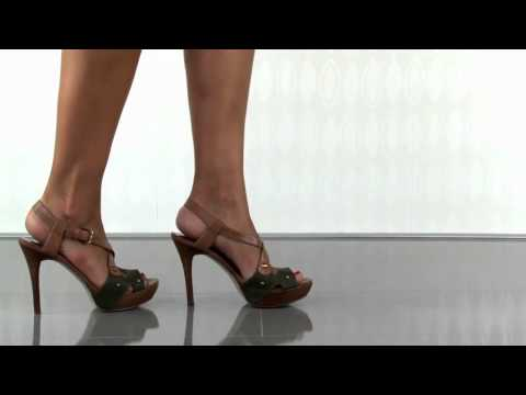 multiple heels and shoes - Visit: http://www.heels.com/womens-shoes/belloma-green-multi-leather.html Be the belle of the ball in these sexy platforms. Guess's Belloma has a cognac leat...