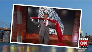 Forget the big sunglasses or using your hand to stop that unwanted photo from being taken, celebrities like Kim Kardashian no longer hanve anything to fear from photographers. Richard Quest demonstrates how one simple scarf turns into the anti-paparazzi paraphernalia.