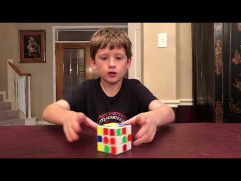 9 Year old solves Rubik's Cubes while reciting Pi to 170 digits