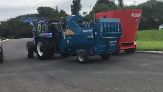 7. New Holland T5 Utility and Kidd Bale Shredder 450
