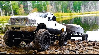 RC Boat launch with Ford Powerstroke 4x4 RC Truck and boat trailer!I hope you enjoy this RC boat launch in 4k!Today we take a 4x4 Ford F350 Powerstroke rc truck, connected to a custom made rc boat trailer, and put it to the test! Launching a boat on an rc boat trailer is not an easy task! It wants to jack-knife like crazy and these little 1.9 tires and very light 4x4 scale rc truck have a rough time hauling such a big boat!The rc boat trailer in this video is custom made out of steel bar and uses traxxas slash 4x4 wheels and tires.The boat in this video is an old school traxxas nitro vee rc boat from many years ago! I have converted it from nitro to electric.The truck in this video is an axial scx10 4x4 scale truck chassis with many mods.#rc #rctruck #rcboattrailer #rcboatlaunch #rcboat #rclaunchingboat #rcfrenzy #rccars #rchauling #rcwithtrailer #axialscx10 #traxxasboat #4k #powerstroke #fordpowerstroke