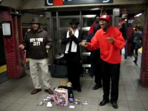 Four singers in a NYC subway just doing their thing.