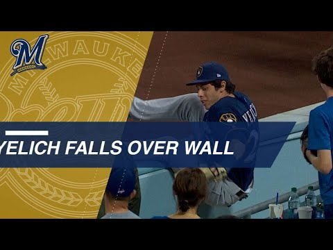 Video: Yelich races for nice catch, tumbles over the wall