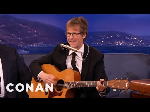 neil - Dana busts out the guitar and harmonica and improvises a ditty about LaBamba's new horn. More CONAN @ http://teamcoco.com/video Team Coco is the official YouTube channel of late night host...