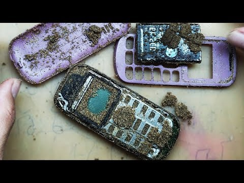 Restoration Mobile Phone Nokia 1280 From Sand