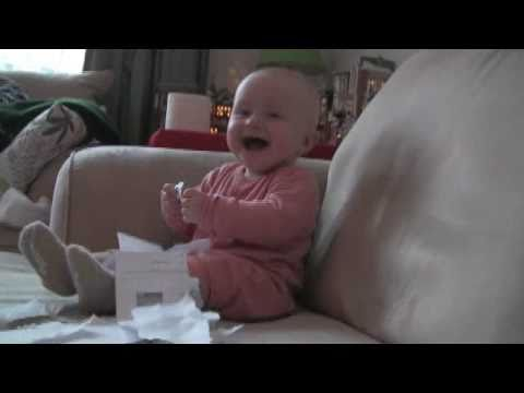 Baby laughing when ripping paper