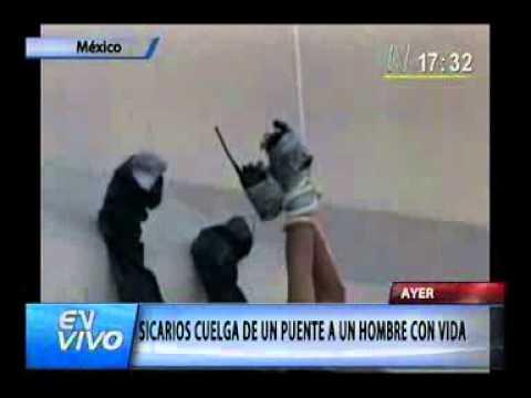 CUELGAN UN HOMBRE VIVO Y MUERTO EN MEXICO, MONTERREY.