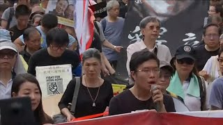 On the 20th anniversary of Britain's handover of Hong Kong to China, thousands of people filled parts of downtown Hong Kong Saturday demanding the ...