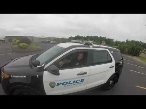 Woman almost hits biker by merging, gets caught by cops