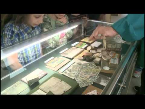 Heads or Tails: Money Makes Their World 'Go-Round' at the Littleton Coin Company
