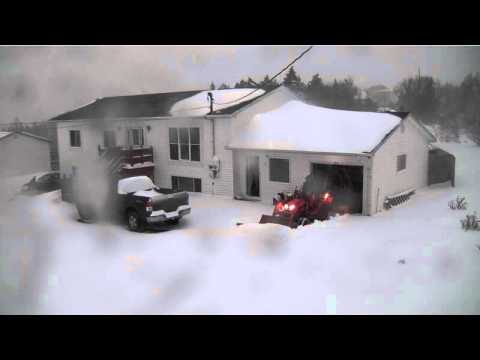 Security camera video of Bxpanded snow plow on Kubota BX