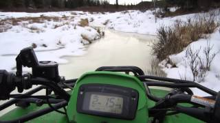 7. 2005 Arctic Cat 500 down icey creek