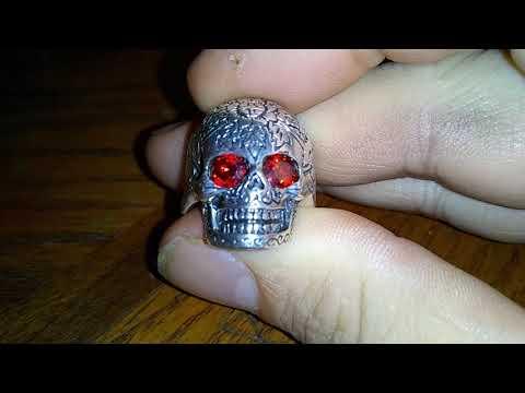 My silver skull ring with Garnet gemstones from wish.com