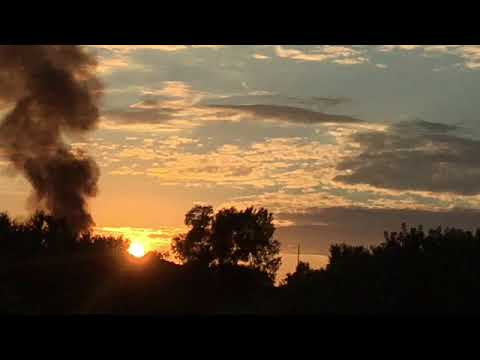 Barr House Explosion Sun Prairie Wisconsin smoke cloud at sunset