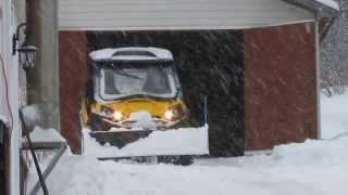 4. 2014 Canam Commander 800 pushing snow