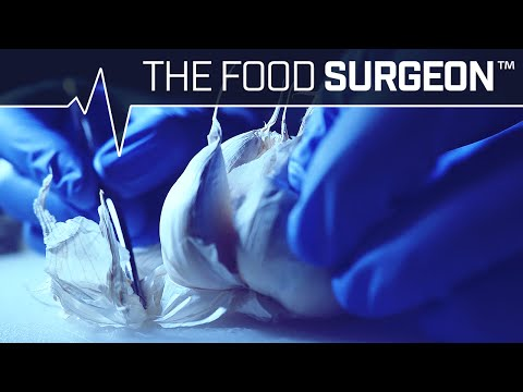 The Food Surgeon Carefully Dissects a Garlic