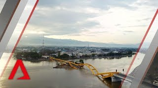 Video Drone footage of tsunami-hit Indonesian city Palu MP3, 3GP, MP4, WEBM, AVI, FLV April 2019