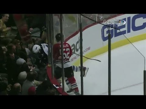 Video: Bollig sends Pardy through the glass on hit
