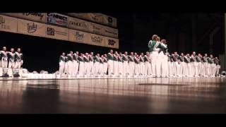 The 2015 Madison Scouts sing their corps song, You'll Never Walk Alone, for their encore during a standstill performance at the rained out Muncie show.