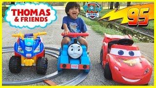 Ryan riding Disney Cars Lightning McQueen and Paw Patrol Power Wheels