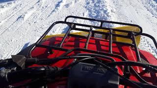 1. 1991 Honda TRX300FW Fourtrax 300 4x4 plowing snow.