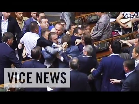 Brawl - Subscribe to VICE News here: http://bit.ly/Subscribe-to-VICE-News Footage shows a brawl between oppositional Ukrainian party members in parliament today. The fight was between members of the...