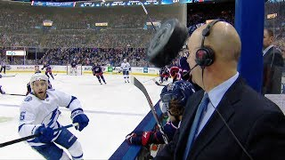 Hockey gods on Pierre McGuire's side after puck flies between the benches by NHL
