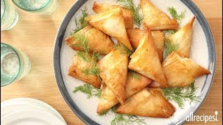 Get the recipe for Phyllo Turnovers with Shrimp and Ricotta Filling at: http://allrecipes.com/recipe/143013/phyllo-turnovers-with-shrimp-and-ricotta-filling/ Impress guests at your next soiree with delicate pastry triangles filled with a rich cheese and seafood filling. Create the filling from celery, bell pepper cooked in butter, green onions, Tabasco hot sauce, salt, flour, chopped shrimp, ricotta cheese and milk. Wrap teaspoons of filling in phyllo, seal with butter and bake up crisp and tempting.Subscribe to Allrecipes @ http://www.youtube.com/subscription_center?add_user=allrecipesAllrecipes Magazine is now available!U.S. subscribers, subscribe here: http://armagazine.com/subscribenowCanadian subscribers, subscribe here: http://themeredithstore.ca/p-282-allrecipes-subscription.aspxFacebookhttp://www.facebook.com/AllrecipesTwitter @Allrecipes