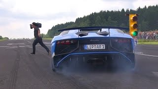 This video features a stunning blue Lamborghini Aventador LP750 SuperVeloce Roadster that almost hits a cameraman while...