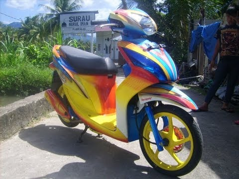 Modifikasi Honda Spacy Arzy dengan airbrush grafis minimalis.Warna