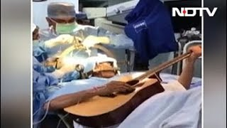 A man who strummed the guitar as surgeons at a Bengaluru hospital operated on his brain showed how the unusual procedure had cured the problem that was hindering his ability to play. Abhishek Prasad, a 37-year-old software engineer, had been suffering a neurological disorder that caused his fingers to cramp in his left hand, preventing him from playing the guitar properly. And so, on July 11, Mr Prasad strummed his guitar as surgeons drilled into his brain for some very delicate surgery. He was fully conscious throughout the procedure.NDTV is one of the leaders in the production and broadcasting of un-biased and comprehensive news and entertainment programmes in India and abroad. NDTV delivers reliable information across all platforms: TV, Internet and Mobile.Subscribe for more videos: https://www.youtube.com/user/ndtv?sub_confirmation=1Like us on Facebook: https://www.facebook.com/ndtvFollow us on Twitter: https://twitter.com/ndtvDownload the NDTV Apps: http://www.ndtv.com/page/appsWatch more videos: http://www.ndtv.com/video?yt