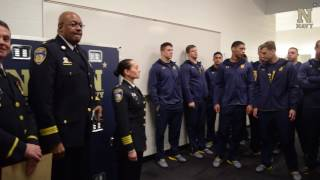 Navy Football - Baltimore PD Presents Thin Blue Line Flag to Paul Carothers
