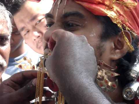 Tongue Piercing at Thaipusam in Penang