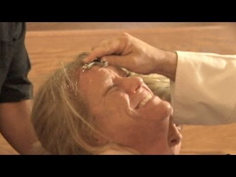 exorcism - Behind the scenes as priest casts demons out of possessed woman.