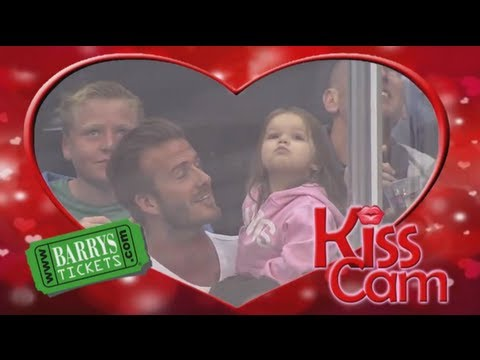 When The Kiss Cam Lands On Her She Isn't Sure Who To Kiss. What She Does Next? Everyone Laughs!