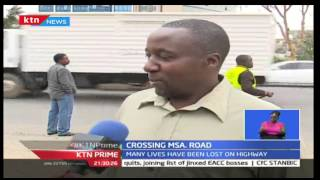NTSA Officers Are Trying To Help Kenyans Cross The Busy Mombasa Road Due To Enough Footbridges