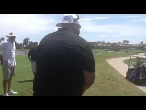 Mike Tyson meets Brodus Clay at the WrestleMania Pro-Am Golf Tournament