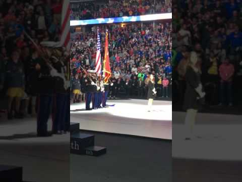 High School Junior crushes National Anthem at State Wrestling Finals in Iowa.