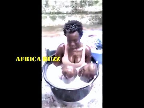 AFRICAN BLACK GIRL TAKES A BATH OUTSIDE