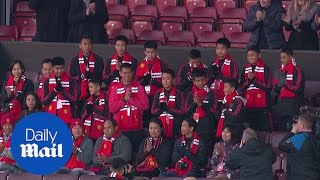 Thailand schoolboys rescued from cave attend Manchester United match