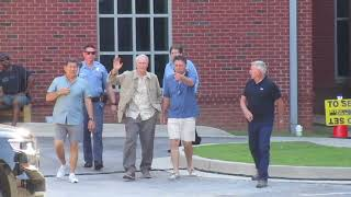 CLINT EASTWOOD LEAVING THE AUGUSTA MUSEUM WHILE SHOOTING A MOVIE