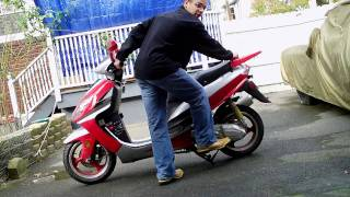10. How to put scooter on center stand