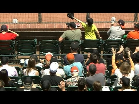 This Kid saves his dad at a baseball game with a stunning snag!