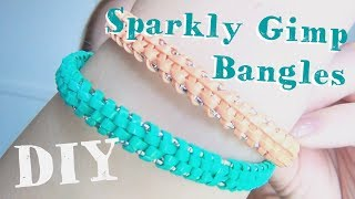 "In this simple, DIY I show you how to make these fun, sparkly boondoggle bangles out of just plastic lace and small metal bangles. It's super easy, super simple, and really fun to make them.Music by Topher Mohr and Alex Elena ""Fortaleza"" Youtube audio library.♥♥♥♥♥♥♥♥♥♥♥♥♥♥♥♥♥♥♥♥♥♥♥♥♥♥♥♥♥♥♥♥♥♥♥♥♥♥♥♥♥♥♥♥Follow Katrinaosity...On Etsy ♥ http://www.etsy.com/shop/katrinaosityOn Facebook ♥ https://www.facebook.com/pages/Katrinaosity/166748913427585On Tumblr ♥ http://katrinaosity.tumblr.com/On Twitter ♥ https://twitter.com/KatrinaosityOn Pinterest ♥ http://pinterest.com/katrinaosity/On Polyvore ♥ http://www.polyvore.com/katrinaosity/♥♥♥♥♥♥♥♥♥♥♥♥♥♥♥♥♥♥♥♥♥♥♥♥♥♥♥♥♥♥♥♥♥♥♥♥♥♥♥♥♥♥♥♥♥Mail:Katrina SherwoodPO Box 1126 Culver City, CA90232Hi, I'm Kat, and I make lots of DIY videos, about everything from DIY jewelry, home decor, gifts, and crafts, to Gluten Free recipes, No-poo hair care, DIY hair extensions, how to make sugaring wax and arabic wax for natural hair removal, and how to make a bracelet out of a toothbrush. Here you can watch videos about friendship bracelets, whitening your teeth with activated charcoal, or even skip on over to my second channel for Story Time videos and vlogs!Shiny, Pretty Things!"