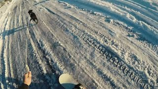 Having my dog Mya pull me threw our neighborhood on my snowboard after the big winter storm of 2017