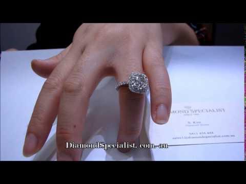 1.5 carat cushion cut diamond with halo setting