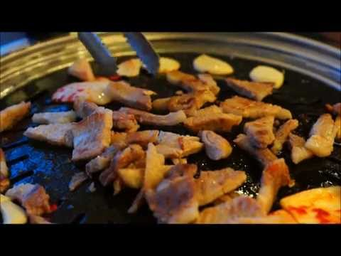 Cooking Meat At A Korean Barbecue