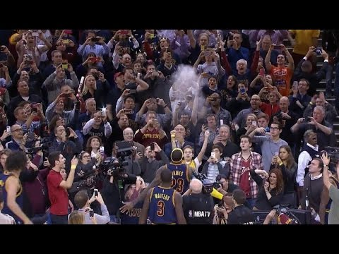 At - LeBron James unleashed a chalk toss prior to the Cleveland Cavaliers' 2014-15 season opener against the New York Knicks at the Quicken Loans arena.