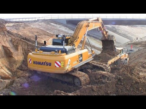 Komatsu PC450LC-7 Excavator Loading Cat 735B and Volvo A30 Dumpers